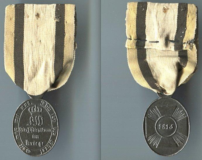 Abb. 41: Nicht-Kombattanten-Medaille 1815; 7,7 g mit original vernähtem Seiden-Bandstück.